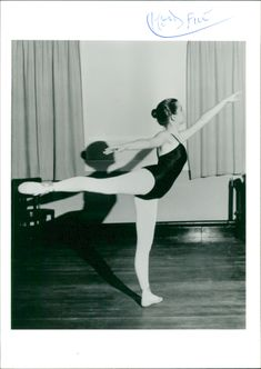 A woman practicing ballet.