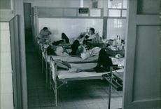 Patients lying on the bed at the hospital ward in Vietnam. 1967.