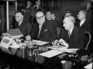 Belgium's Prime Minister Spaak, in the middle, at the first Consultative Council meeting with the Western Union states.