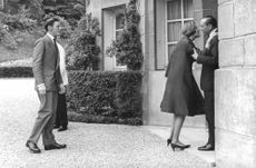 Princess Alexandra kissed a man on cheek, with Angus Ogilvy.