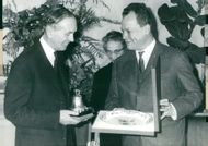 UK Secretary of State Lord Alec Douglas-Home receives a gift from Willy Brandt while visiting Berlin