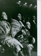 Edna Mae Holly the wife of Sugar Ray Robinson watching his fight, 1962.