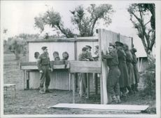 "1944 Italy -  Fifth army troops mine school. A general view of the school's ""Momscar Stocks"", used in training students to disarm mines by night."