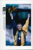 Ludmila Engquist with his gold medal for the 100 m win at the award ceremony during the Atlanta Olympic Games in 1996