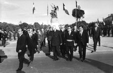Charles André Joseph Marie de Gaulle, with people, on road.