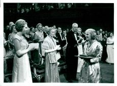 Dorothy Crowfoot Hodgkin receives the Nobel Prize. In the background you can see Queen Louise Mountbatten and King Gustaf VI Adolf