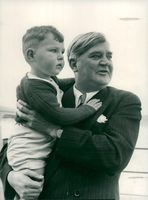 Aneurin Bevan with a parish colleague's boy in his arms