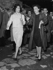Princess Margaretha walking with woman.