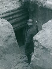 A Finnish soldier standing at the entrance of a tunnel during the war, Finland, 1939.