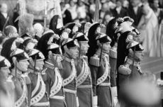 Vatican guards standing straight during a mass.