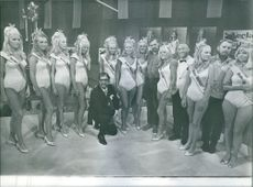 """A moment captured from Swedish comedy film """"Miss and Mrs. Sweden"""" from 1969 directed by Goran Gentele."""
