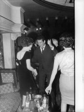 Man and woman in a party twisting and dancing in England, 1962.