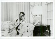 US President Ronald Reagan speaks on the phone with Vice President George Bush regarding the Grenada situation