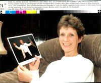 Fiona Castle holds a photograph of her husband Roy Castle.