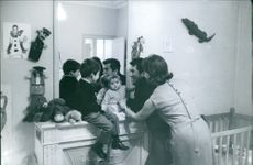 Daniel Gelin and his wife Sylvie Hirsh playing with children.
