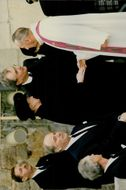 Henrik, Prince Consort of Denmark with his wife Margrethe II of Denmark meet the priest.