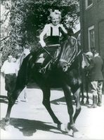 Beatrix in her childhood enjoying horseback riding.  1966