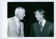 Robert Mitchum (right) attended the party at a cocktail reception hosted by Jane and Vernon Scott at Chasens.