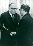 Franco Maria Malfatti and Mr. Schumann are seriously talking.