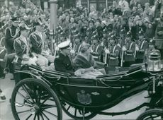 Princess Beatrix parade in an open carriage.