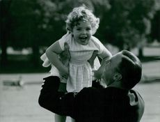 John Ambler playing with child.
