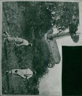 Women golfers survey the scene of the crash landing on the course in 1937