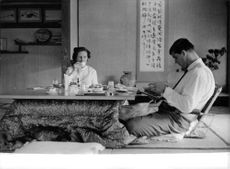 A man dining with a woman.