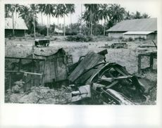 SUMATRA REBELS. Scars of the fighting with the Dutch still remain in and around Padang. Mined and wrecked vehicles still litter the town from the days of the heavy fighting after the surrender of Japanese forces in 1945.
