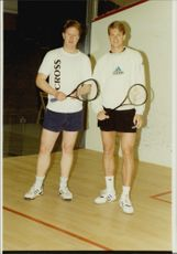 Tennis players Mike Dickson and Stefan Edberg face a tennis match