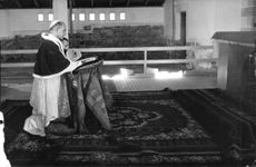 Pope Paul VI is praying in the church, while he kneeling