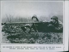Red soldiers in action on the Kharkov front with one of the new Russian two-man anti-tank guns, which are proving so deadly.  1942
