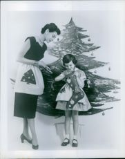 Child giving gift to woman from the bag.