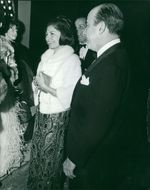 Princess Soraya in a party, talking to the people.