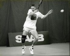 Tennis player Henrik Holm in action