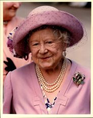 Queen Elizabeth in pink hat with a matching skirt.