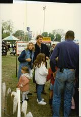 Golf player Nick Faldo with girlfriend Brenna Cepelak and her daughters Georgia and Natalie at the Royal Windsor Horse Show