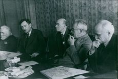 Nikolai Bulganin sits with four eminent scientists, 2nd from the left.