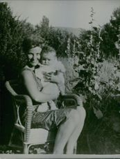 Princess Alexandra siting in the chair with her son,James Ogilvy.