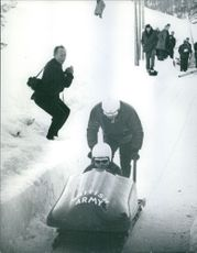 Prince Michael of Kent riding a bobsled.