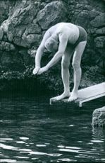Nubar Sarkis Gulbenkian about to jump dive to a pool.  1964,