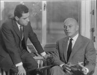 Yul Brynner talking to a man.