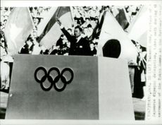 The Olympic delegation's Japanese captain Takashi Ono swears an oath during the opening of the Olympic Games