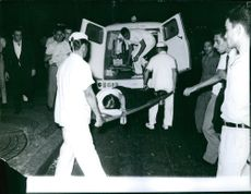 Patient being carried into ambulance from a Basilica.