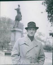 Einar Beyron standing in the street while facing the camera, 1942.
