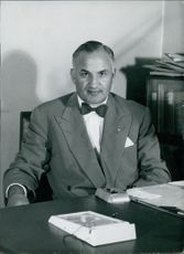 Dr. A. Philip Magonet at his desk in his office.