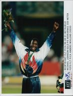 Michael Johnson with his 200m gold medal at the awards ceremony during the Olympic Games in Atlanta in 1996
