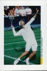 Andre Agassi competes during the Wimbledon Tournament.