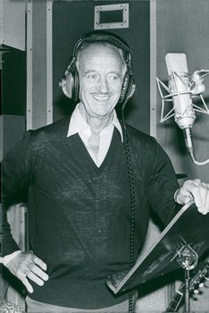 David Niven recites poetry for the recording of an LP