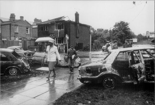A well-burned house and burned cars after the riots in Tottenham