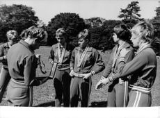 Team of young athletes are wearing the medals they've won in a competition.  - Oct 1964